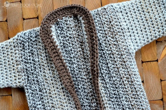 Crocheting the collar on the cozy coed cardigan