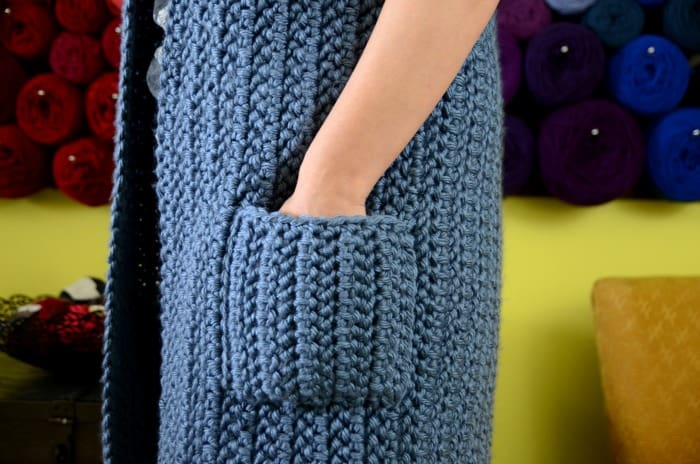 Pockets on a blue crocheted housecoat