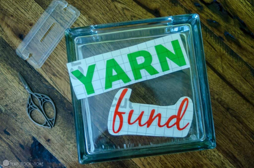 adding yarn fund decal to square piggy bank