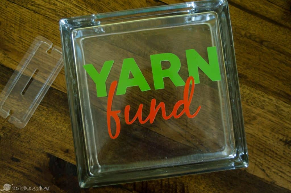 making a yarn fund piggy bank with glass block
