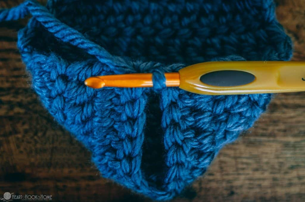 Creating the heel of chunky slipper using blue yarn