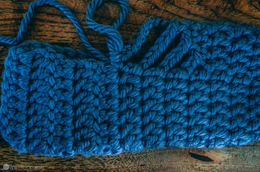 Finishing the second side of the chunky slipper with blue yarn