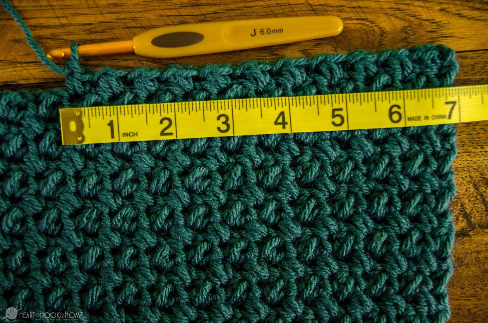 measure tape measuring out crochet stitches