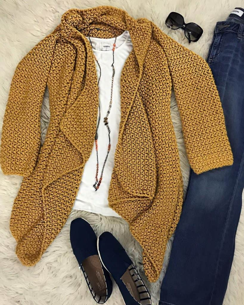 gold cardigan with shoes and necklace, sunglasses and jeans
