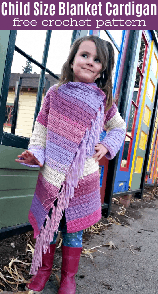 child wearing pink and purple blanket cardigan