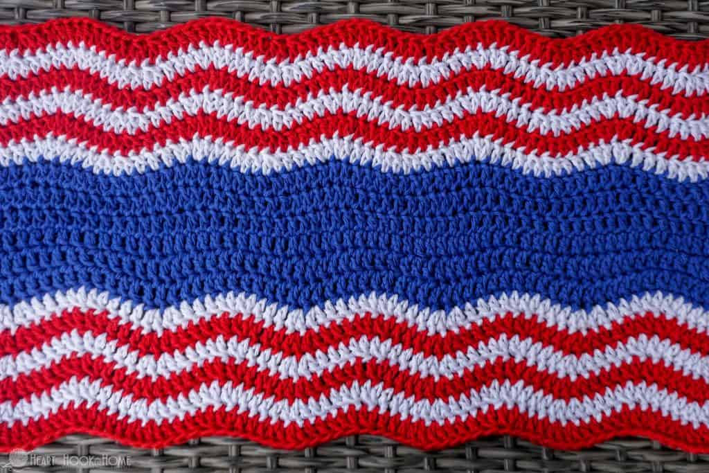 Wavy red, white, and blue crocheted table runner