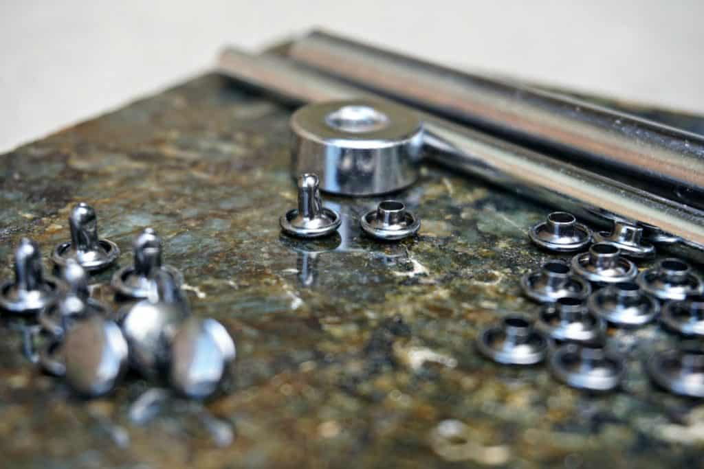 How to use a double cap rivet tool