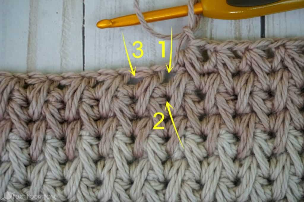 Pulling up loops for feather stitch