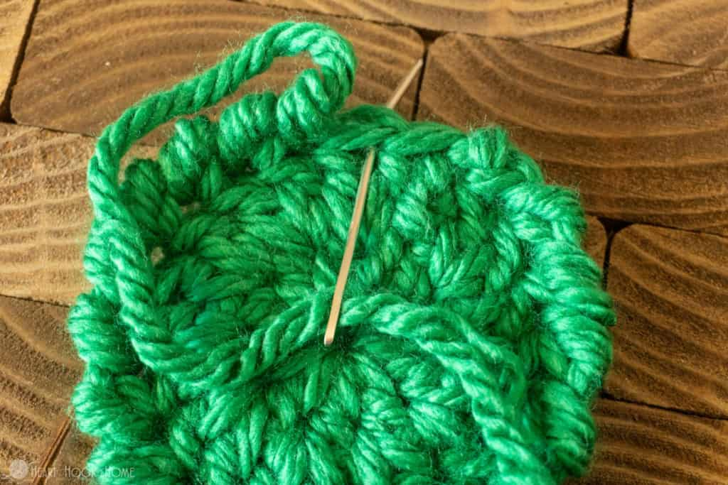Fastening off crab stitch in the round