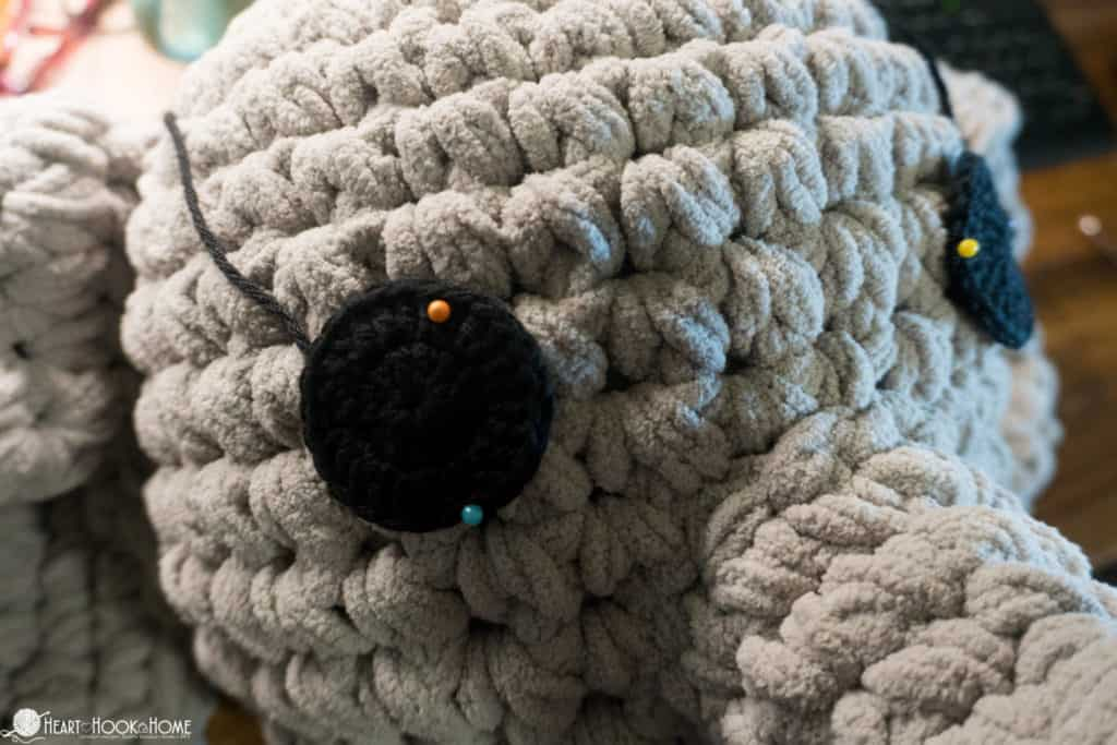 Placing eyes on elephant pillow