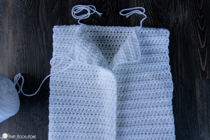 Sewing shoulders of crocheted cardigan